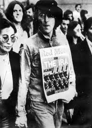 John Lennon carrying a copy of Red Mole.