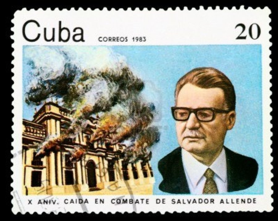 Stamp issued in Cuba on the tenth anniversary of the coup, depicting Allende and the burning of the Moncada palace.